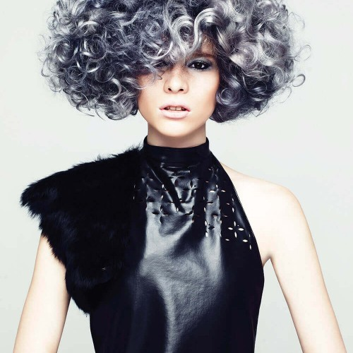 Model with curly greyish hairstyle