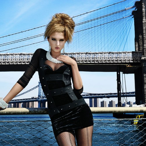 Model posing with a unique hairstyle with a bridge backdrop