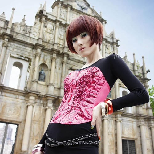 Model with short dyed hair showing off her new look